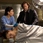 "Supernatural -- ""Love Hurts"" -- Image SN1113B_0039.jpg -- Pictured (L-R): Carmen Aguirre as the Coroner, Zoe Fraser as Staci Altman and Jared Padalecki as Sam -- Photo: Jack Rowand /The CW -- © 2016 The CW Network, LLC. All Rights Reserved"